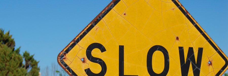"caution ""Slow"" sign"